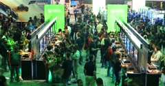 Crowds of gamers playing games in Microsoft XBOX booth at E3 2016 expo Arkistovideo