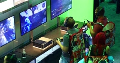 Gamers playing demo game in Microsoft XBOX booth at E3 2016 expo Stock Footage