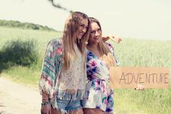 Female twins. vacation concept. color filter. independent travel Stock Photos