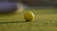 Playing mini golf in the summer close-up Stock Footage