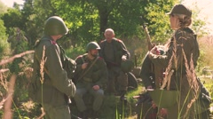 Soldiers talking and waiting in camp near frontline Stock Footage