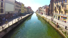 Tourists walking and swimming in the Navigli district, Milan, Italy Stock Footage