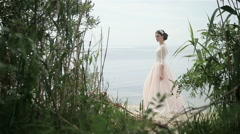 Bride posing on the river bank Stock Footage