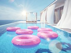 Luxury swimming pool with swimmrings. 3d rendering Stock Illustration