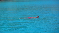 Zoom out kid snorkeling Stock Footage