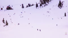Time Lapse - Skiers Skiing Down the Slope at Ski Resort Stock Footage