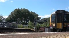 Low angle shot of Train pulling into station Stock Footage