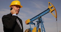 Extracting Oil Company Manager Talking Mobile Asking Production Staff Report Stock Footage
