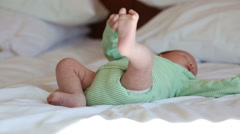 Newborn baby lying on a bed Stock Footage