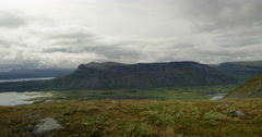 Hiker walking by. Hiking in Sarek view over Rapadalen. Stock Footage