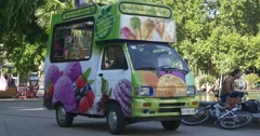 Ice cream van in park in hot summer day Stock Footage