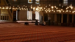Men pray in the mosque Stock Footage