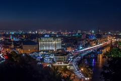 Kiev. Night. View of the Dnieper River and area Podol. Stock Photos