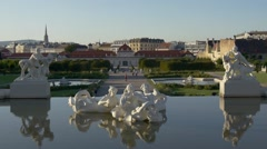Sculptures in fountain of Belvedere palace with Vienna cityscape Stock Footage