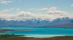 Time Lapse - Ariel View of Lake Tekapo with Mountain Range Stock Footage