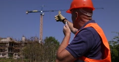 Worker Use Radio Station Coordinating Heavy Crane Machinery Building Site Area Stock Footage