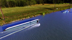 Aerial Wakeboarding in a Lake With Wake Park Stock Footage