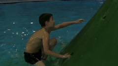 Boy Climbing to the Top of Water Slide in the Aqua Park. Stock Footage