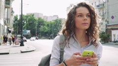 Attractive woman with curly hair traveled on a new city Stock Footage
