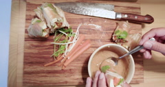 Woman Eating Food. Fresh Spring Rolls With Homemade Thai Peanut Sauce. Top Angle Stock Footage