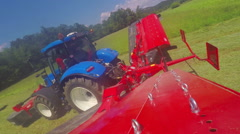 Young farmer stops the tractor and jumps out of it Stock Footage