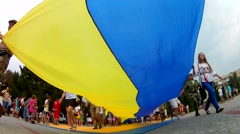 The people  are long flag of Ukraine on a holiday Independence Day Stock Footage
