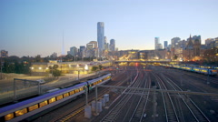 4k moving shot of train departing from a modern city Stock Footage