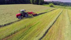 Raking hay and making a straight lane Stock Footage