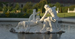 Fountain white sculpture in green garden of Belvedere Stock Footage