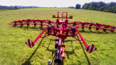 Folding a huge machine with rotary rakes by pushing a button in a tractor Stock Footage
