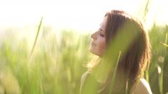 Girl among the high grass wears black sunglasses Stock Footage