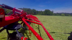 Rotary rakes are working very fast on this hot summer day Stock Footage
