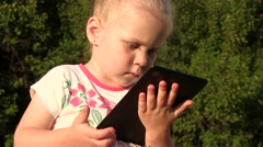 Cute Happy Little Girl Holding A Tablet Stock Footage