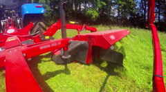 The grass that has been cut is coming out of the machine Stock Footage