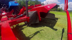 Lifting a grass cutting machine up in the air Stock Footage