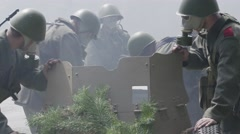 Soldiers moving a anti tank gun to a firing position Stock Footage
