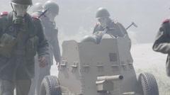 Soldiers hiding a anti tank gun Stock Footage