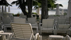 Empty Chairs at a Sea Resort Stock Footage