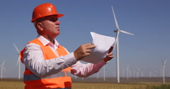 Engineer Manager Check Blueprint Technical Drawing Wind Turbine Farm Paper Plans Stock Footage