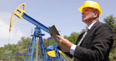 Oil Pump Extracting Company Manager Engineer Planning Monthly Report Production Stock Footage