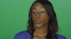 Beautiful African American woman smiling and making silly faces Stock Footage
