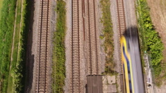 Aerial train passing underneath, straight down Stock Footage