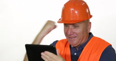 Technical Staff Specialist Use Tablet Read Good News with Successful Expression Stock Footage