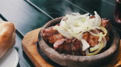 Kebab on a clay plate in Georgian cuisine restaurant. Georgian Food Stock Footage