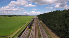 Aerial of train in green summer landscape, Holland. Stock Footage