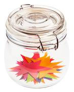Many stars cut out from paper in closed glass jar Stock Photos