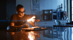 Heating a glass rod with a Torch in a Class Room Stock Footage
