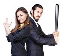 Woman gesturing gun man with bat Stock Photos