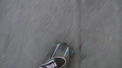 Top view of a guy longboard skating in the city shot on the longboard Stock Footage