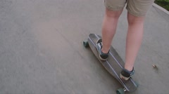 Young cool guy longboard skating in the city Stock Footage